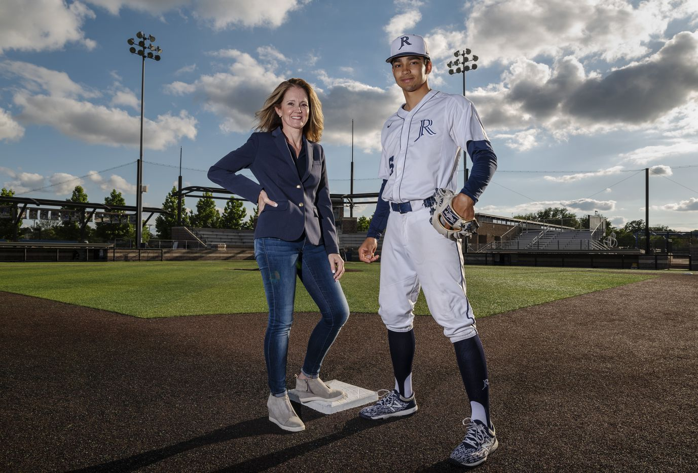 Jesuit senior shortstop Jordan Lawlar, 18, and his mother Hope Lawlar, on the baseball diamond on the campus of Jesuit College Preparatory School of Dallas, on Tuesday, May 04, 2021.