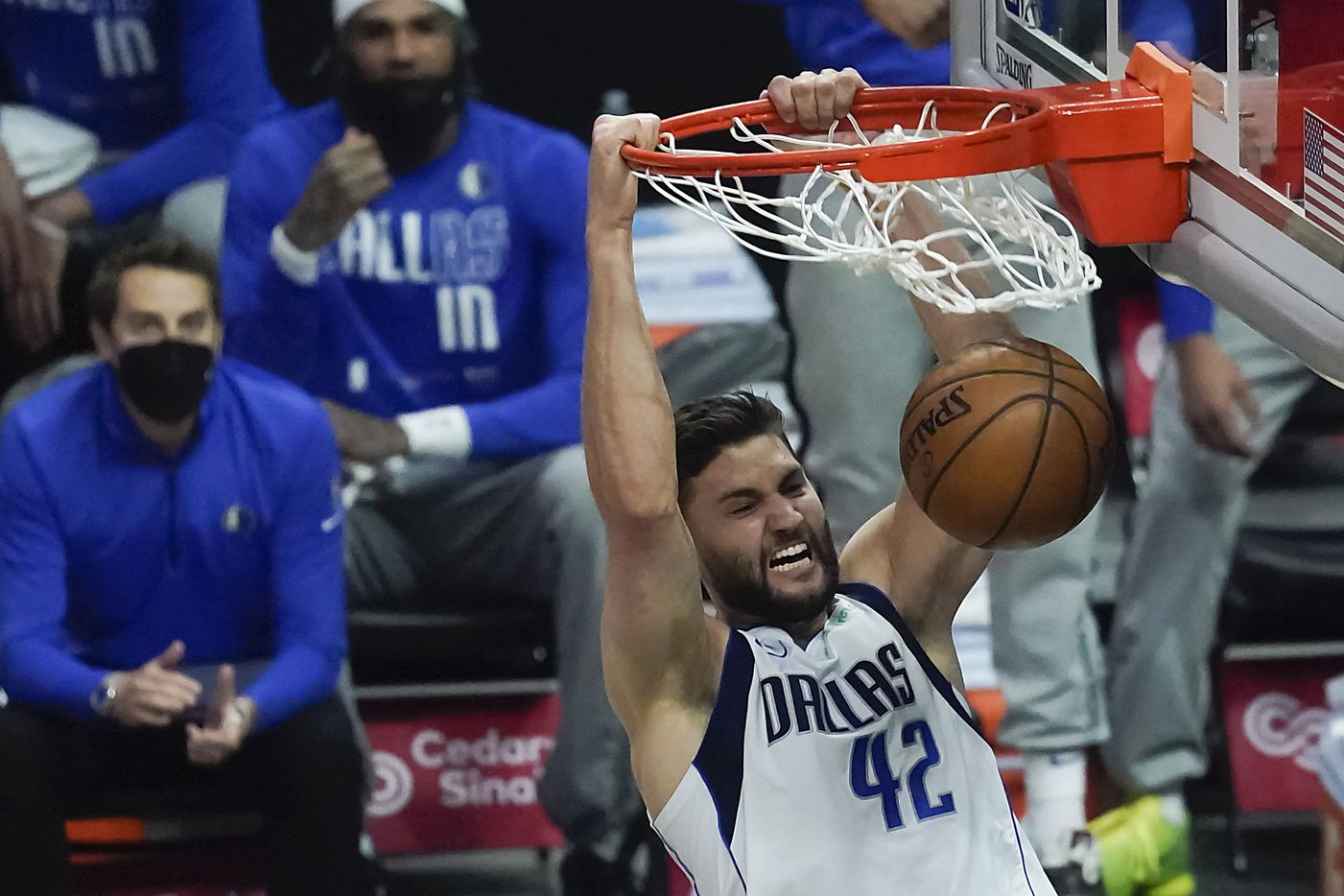 Dallas Mavericks forward Maxi Kleber dunks the ball past LA Clippers forward Marcus Morris Sr. during the first half of an NBA playoff basketball game at Staples Center on Tuesday, May 25, 2021, in Los Angeles.