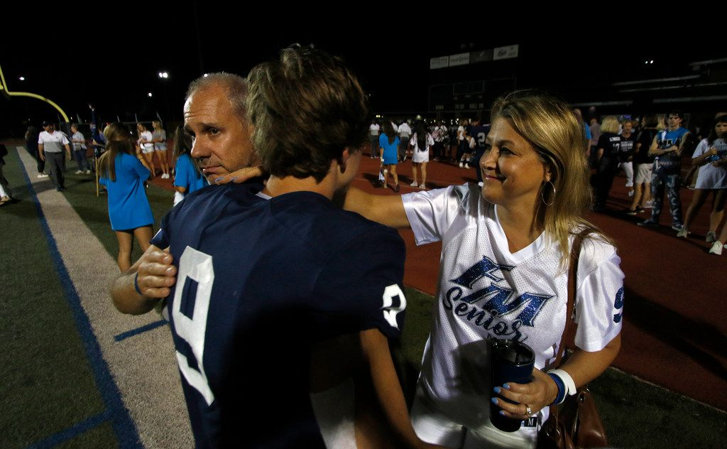 Mark and Beth Winters were quick to offer a consoling hug for their son, senior receiver Carson, after Flower Mound's recent 57-34 loss to Prosper. Carson's return to the gridiron is special for his parents after a serious health scare that resulted in a 20-day hospital stay in April.