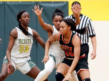 South Grand Prairie's Madison Jean-Louis (25) finds driving the ball challenging against the defense of DeSoto's Kayla Glover (3) and Amina Muhammad (33) during first half action. The two teams played their District 7-6A girls basketball game at DeSoto High School in DeSoto on January 21, 2020. (Steve Hamm/ Special Contributor)