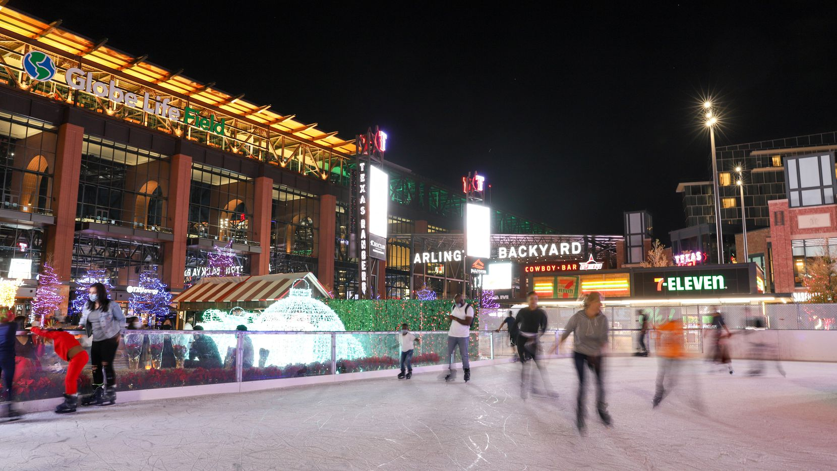 At Luminova Holidays, a new festival at Globe Life Field in Arlington, visitors can skate on a 10,000-square-foot outdoor ice rink.