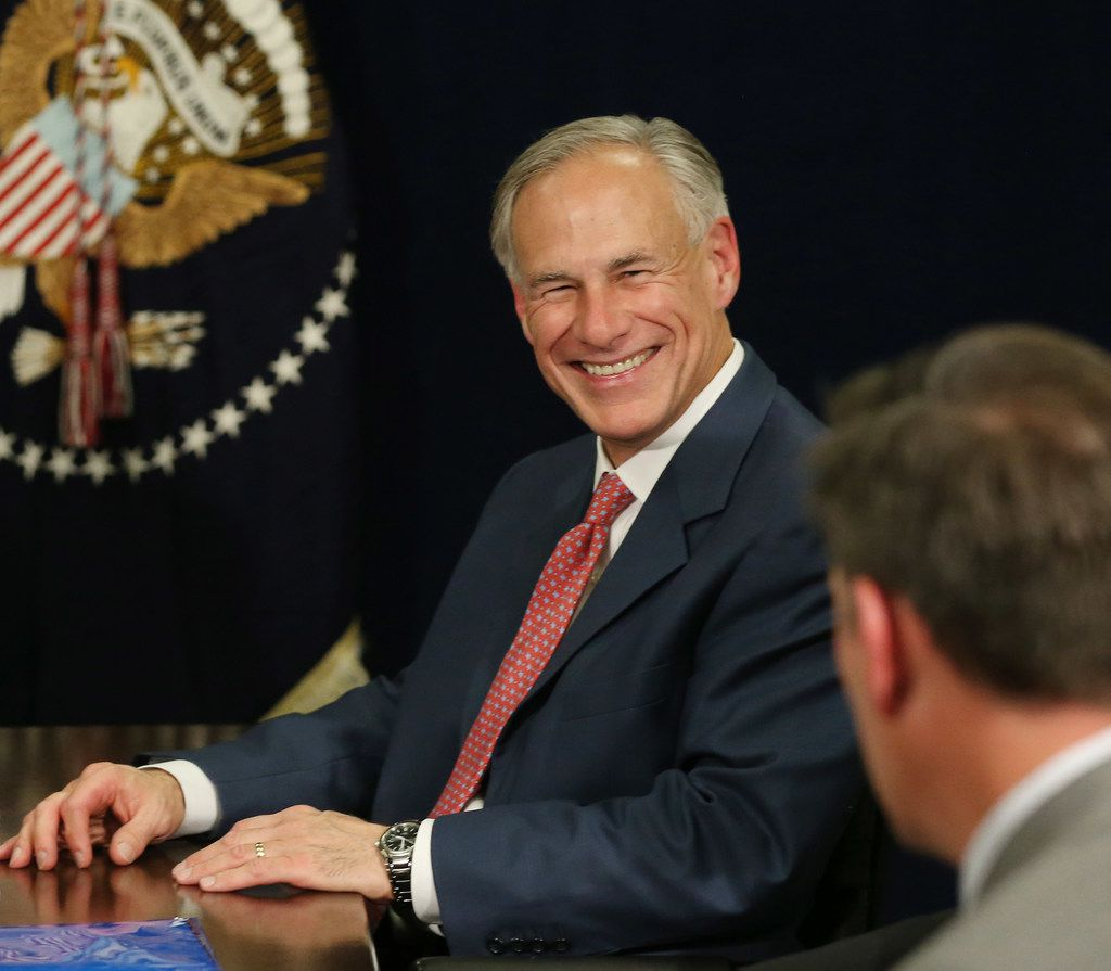 Texas governor Greg Abbott listens while in a hurricane response briefing with President Donald Trump at Signature Flight Support near Love Field in Dallas Wednesday October 25, 2017. President Trump participated in a hurricane recovery briefing, a Republican National Committee roundtable and gave remarks at a reception. (Andy Jacobsohn/The Dallas Morning News)