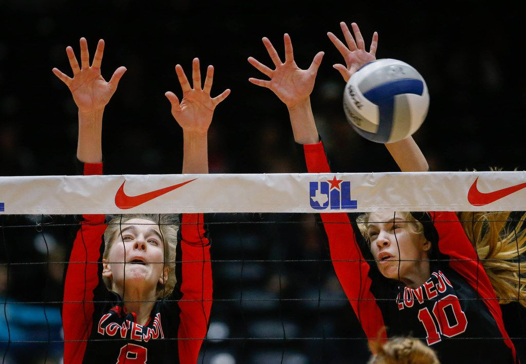 Lovejoy's Brynn Eggar (8) and Grace Milliken (10) attempt to block a Friendswood hit during the first set of a class 5A volleyball state semifinal match at the Curtis Culwell Center in Garland, on Friday, November 22, 2019. Lovejoy won the first set 25-15. (Juan Figueroa/The Dallas Morning News)