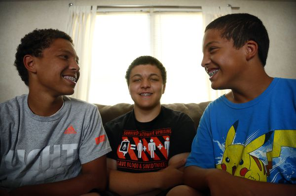 The Ash brothers -- (from left) Marcus, Terrence and Curtis -- got braces through Medicaid at the All Smiles clinic near their Lewisville home. They haven't been back since the orthodontic office closed a couple of months ago.