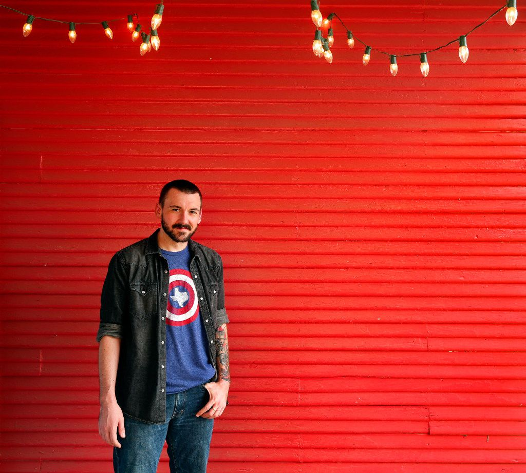 Donny Cates, an Austin-based comic book writer who grew up in Garland, poses for a photo outside Red Pegasus Comics in 2017.