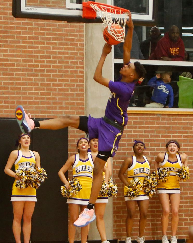Richardson guard Rylan Griffen (3) finishes off an uncontested dunk to the anticipated excitement of Eagles cheeleaders during the final minute of their game against DeSoto. Richardson defeated DeSoto 63-51 to advance. The two teams played their Class 6A boys bi-district playoff basketball game at Forney High School in Forney on February 24 2020. (Steve Hamm/Special Contributor).