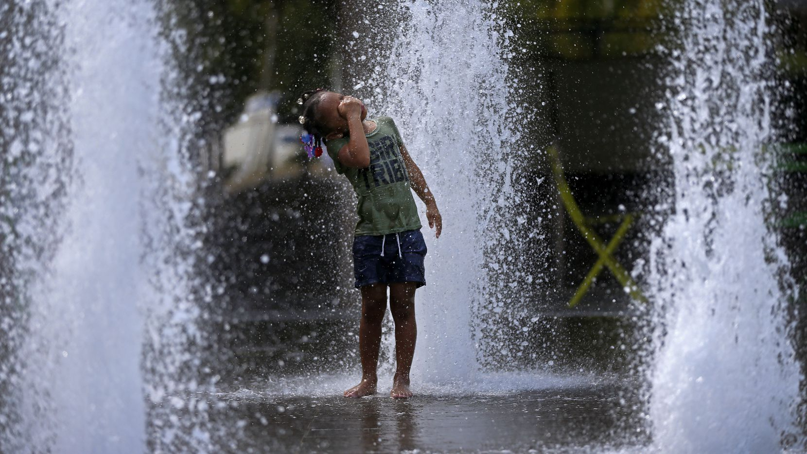 Rhmyeiah Parrish, 5, cooled off in the fountain at Klyde Warren Park in Dallas on July 19 when the temperature in Dallas-Fort Worth hit a record high 108.