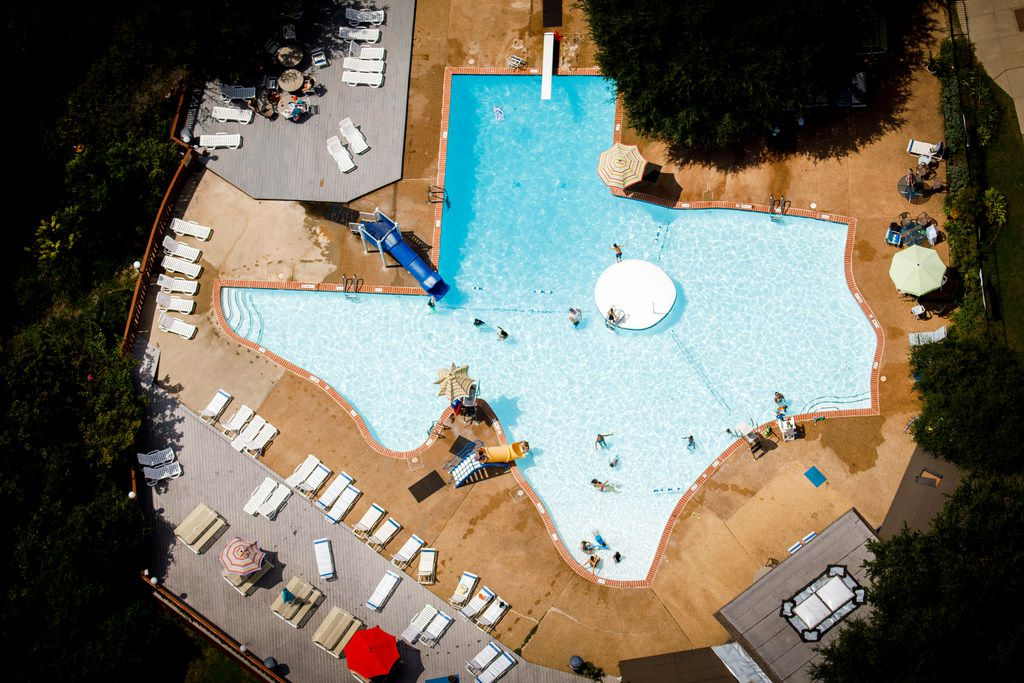 People swim at the Texas Pool on the Creek in 2017 in Plano.