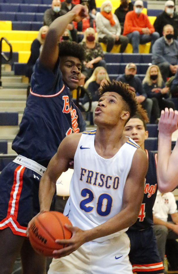 Frisco High School forward Micah Robinson (20) looks to put the ball up under the basket during the first half as McKinney North High School played Frisco High School in a class 5A bit-district boys basketball playoff game played at McKinney High School in McKinney on Monday, February 22, 2021.  (Stewart F. House/Special Contributor)