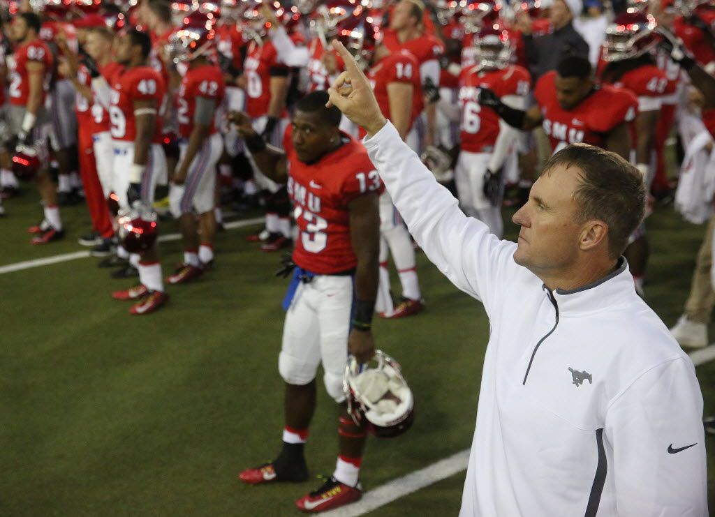 Southern Methodist Mustangs head coach Chad Morris joins his players for the school song following an NCAA football game between Tulsa and SMU at Gerald J. Ford Stadium in Dallas Saturday October 31, 2015. Tulsa Golden Hurricane beat Southern Methodist Mustangs 40-31. (Andy Jacobsohn/The Dallas Morning News)