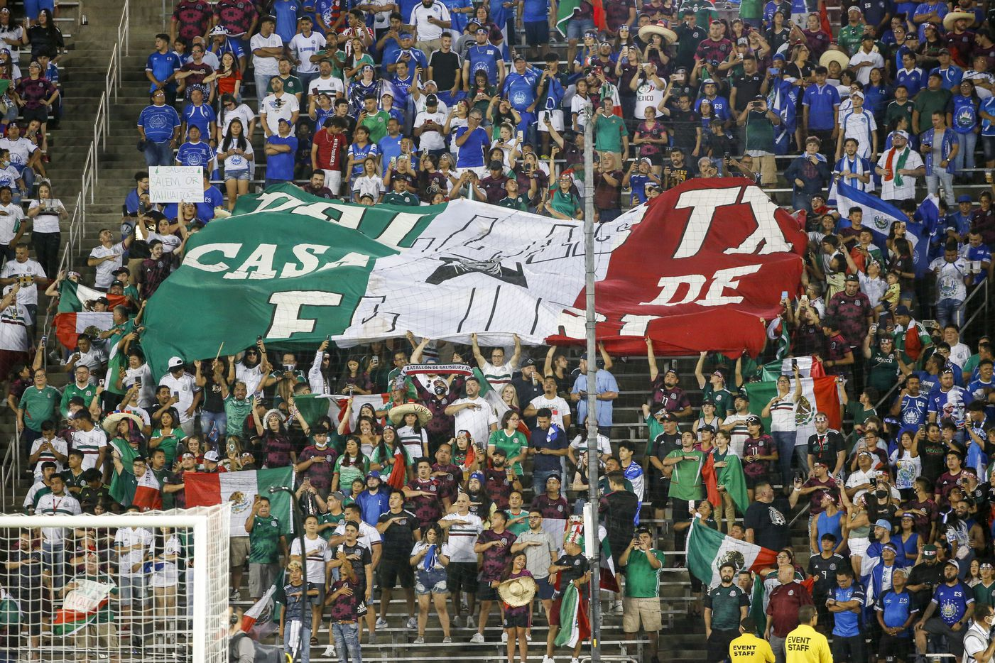 Fans of Mexico wave a large banner during the national anthem of Mexico before a CONCACAF Gold Cup Group A soccer match against El Salvador at the Cotton Bowl on Sunday, July 18, 2021, in Dallas. (Elias Valverde II/The Dallas Morning News)