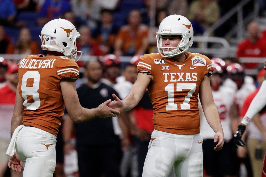 Texas place-kicker Cameron Dicker (17) celebrates his field goal with teammate Ryan Bujcevski (8) during the first half of the Longhorns' 38-10 Alamo Bowl victory against No. 11 Utah in San Antonio, Tuesday, Dec. 31, 2019. (AP Photo/Eric Gay)
