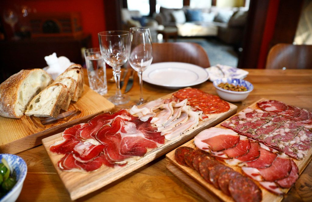 Husband and wife owners of Lucia restaurant, David and Jennifer Uygur, served sourdough bread with boards full of cut meats before Valentine's dinner.