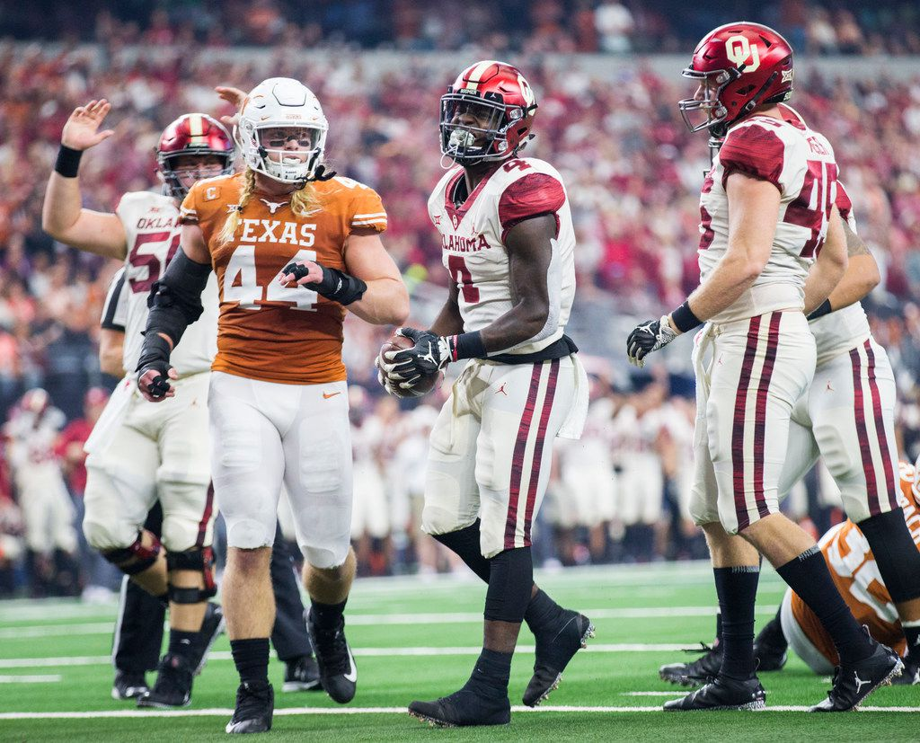 Oklahoma Sooners running back Trey Sermon (4) celebrates a touchdown during the second quarter of the Big 12 Championship football game between the Texas Longhorns and the Oklahoma Sooners on Saturday, December 1, 2018 at AT&T Stadium in Arlington, Texas. (Ashley Landis/The Dallas Morning News)