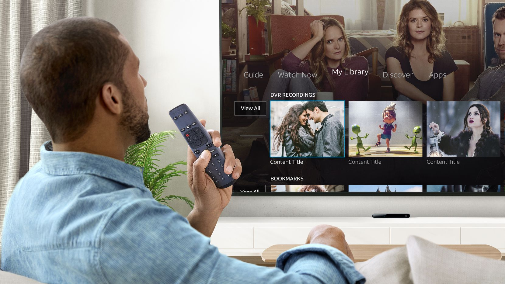An AT&T TV user with a voice remote.