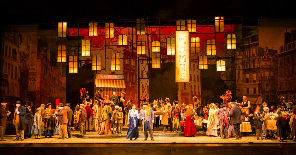 The ensemble performs in Act 2 during the final dress rehearsal of La Bohème presented by the Dallas Opera at the Winspear Opera House at the AT&T Performing Arts Center in Dallas on March 12, 2019.
