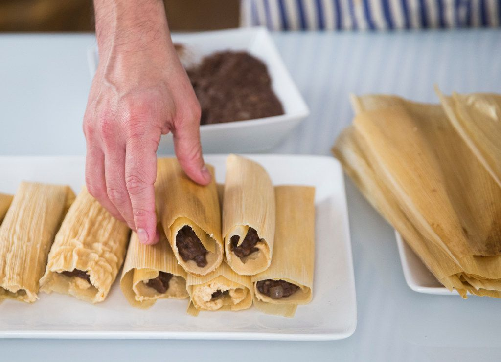 Eddie Garza makes vegan black bean tamales in his apartment on Wednesday, December 21, 2016 in Dallas. Garza lost a significant amount of weight after changing his diet, which included going vegan.