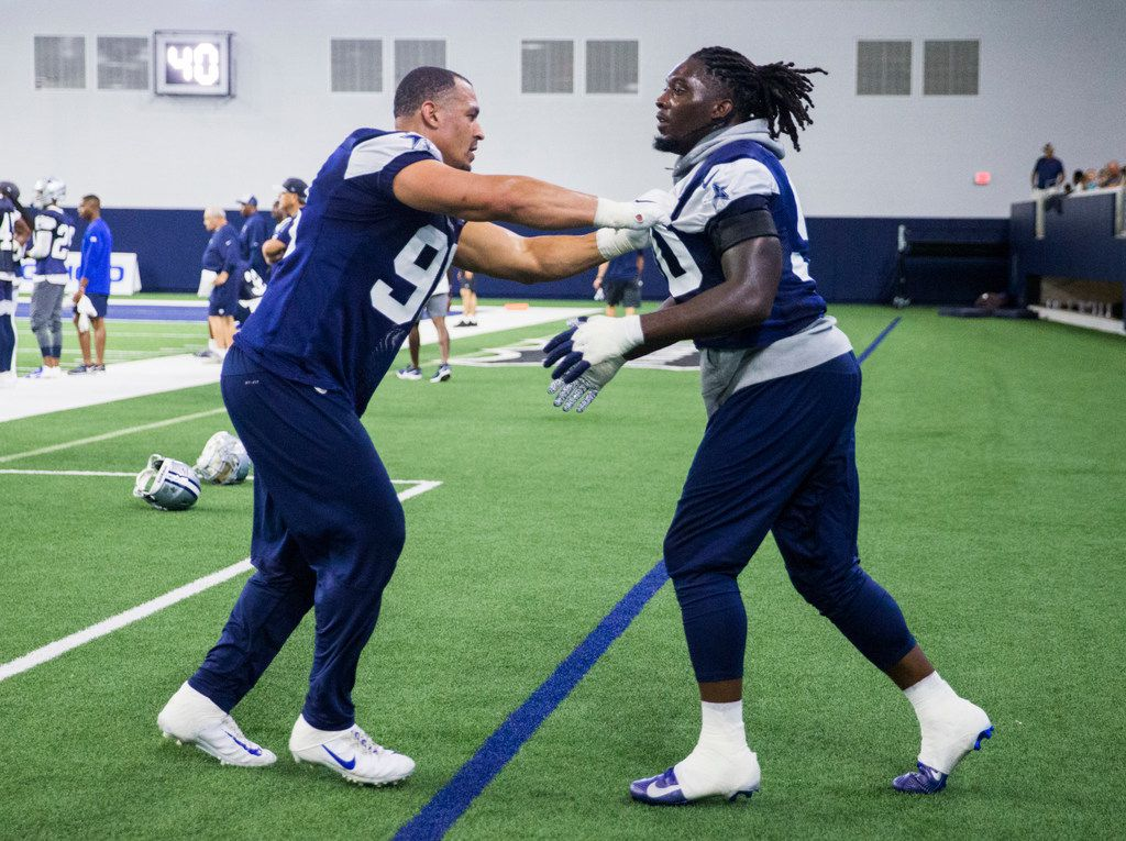 Dallas Cowboys defensive end Demarcus Lawrence (90) takes on defensive tackle Tyrone Crawford (98) during a Dallas Cowboys training camp practice on Thursday, August 22, 2019 at The Star in Frisco. (Ashley Landis/The Dallas Morning News)