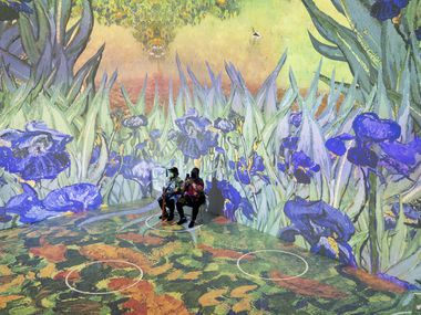 Visitors to 'Immersive Van Gogh' stay socially distanced by sitting on circles separated from other patrons. The Dallas opening was delayed, but the show has opened in other cities like New York, pictured here.