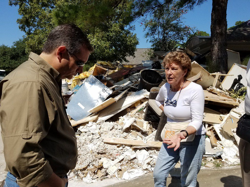 Sen. Ted Cruz speaks with flood victim Cecily Ryan after Hurricane Harvey in the Kingwood section of Houston on Sept. 9, 2017.