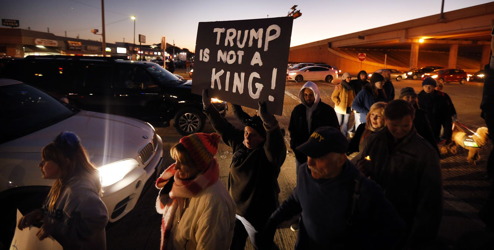 Supporters of U.S. Representative Colin Allred arrive outside his Richardson, Texas office at the intersection of Belt Line Rd and Central Expressway to show their support of President Donald Trump's impeachment, Tuesday evening, December 17, 2019.
