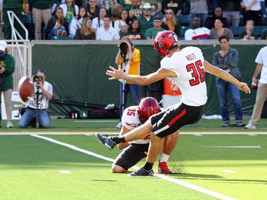 WACO, TEXAS - OCTOBER 12: Trey Wolff #36 of the Texas Tech Red Raiders kicks a field goal against the Baylor Bears in the first half on October 12, 2019 in Waco, Texas.