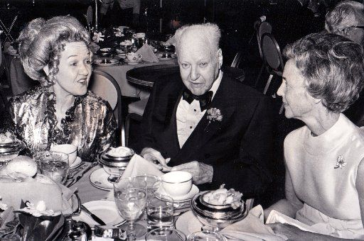 Among the happy throng of partygoers Saturday night at the Petroleum Club ball were H.L. Hunt (center) and his wife, Ruth (left).
