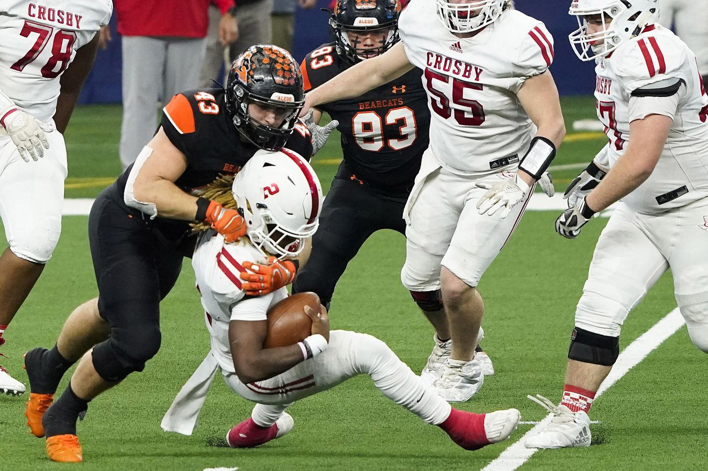 Crosby Deniquez Dunn (2) is sacked by Aledo defensive lineman Kyle Thompson (43) during the first half of the Class 5A Division II state football championship game at AT&T Stadium on Friday, Jan. 15, 2021, in Arlington. (Smiley N. Pool/The Dallas Morning News)