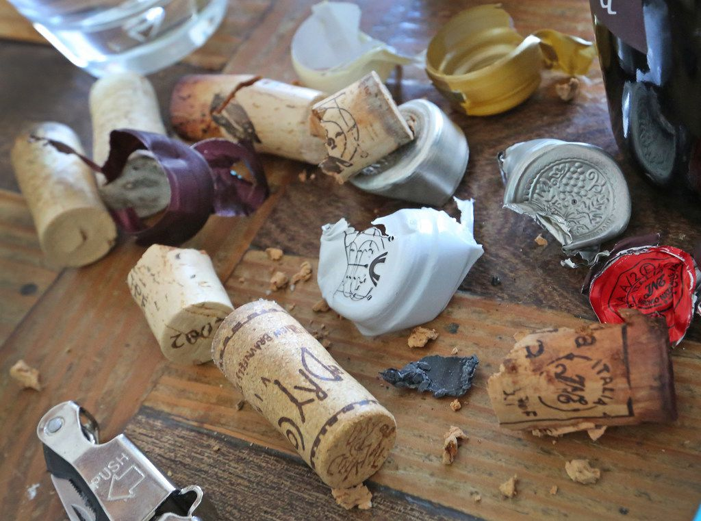 The table becomes cluttered with corks and wrappings from old wine bottles.