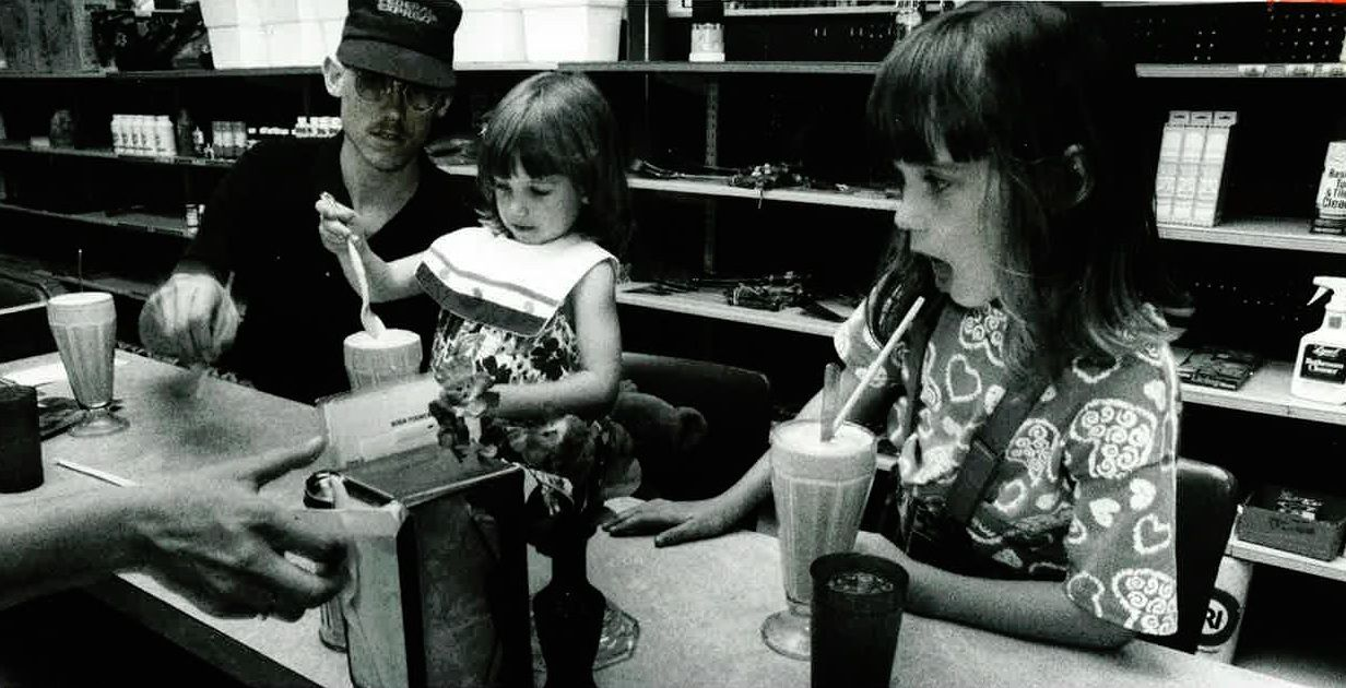 Jonathan Steffins and his daughters, Rebecca and Amanda, enjoyed milkshakes as a late-afternoon snack in 1990 at the soda fountain at Big State Drug Store in Irving.