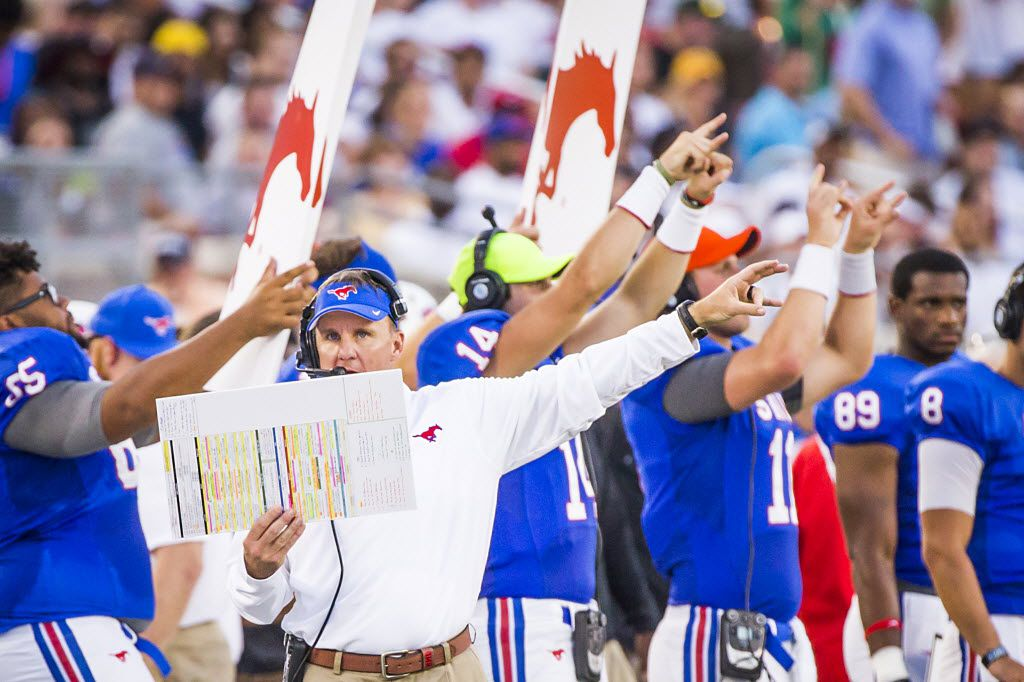 FILE - SMU head coach Chad Morris points instructions to his offense during the second quarter of a game against Baylor at Ford Stadium on Friday, Sept. 4, 2015, in Dallas. (Smiley N. Pool/The Dallas Morning News)