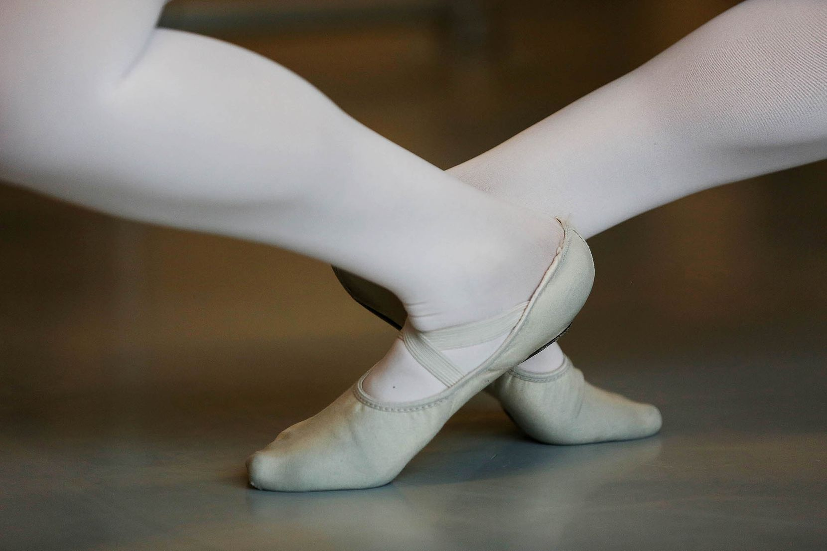 A dancer in a ballet class during the first day of school.