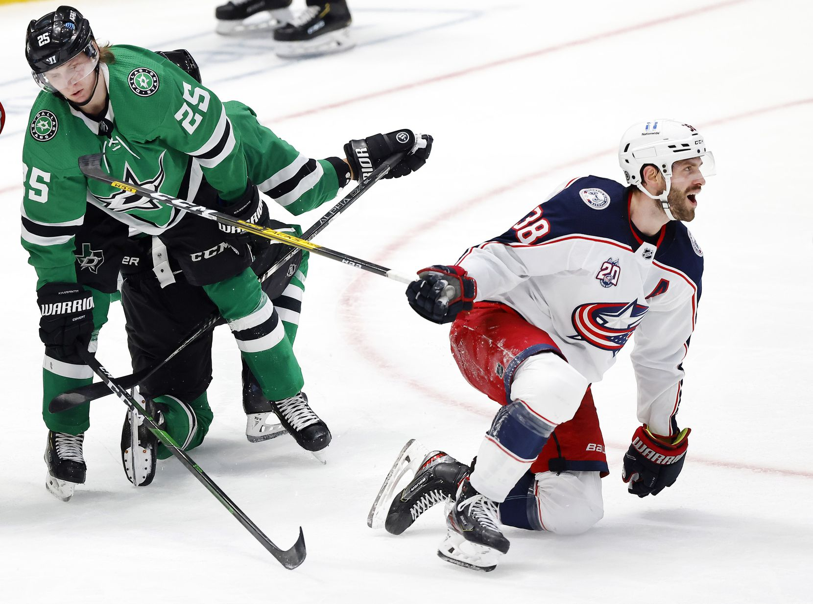 Columbus Blue Jackets center Boone Jenner (38) celebrates his second-period goal against Dallas Stars left wing Joel Kiviranta (25) at the American Airlines Center in Dallas, Thursday, March 4, 2021.