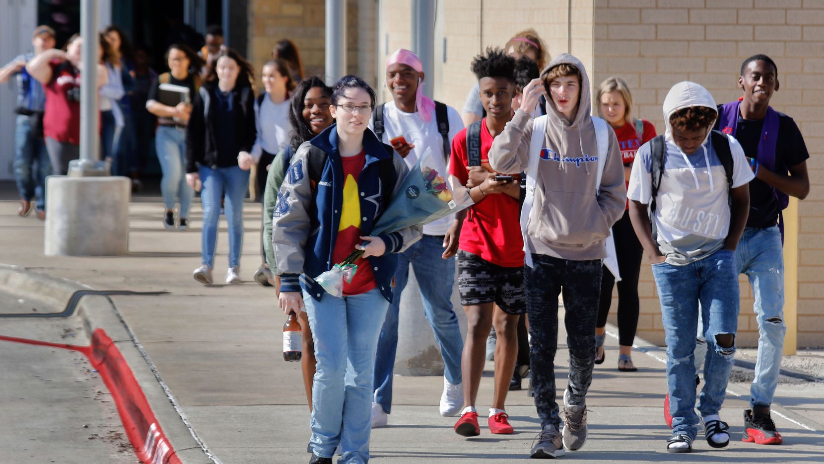 Students at Frisco ISD's Lone Star High School participated in the National School Walkout on Friday morning.