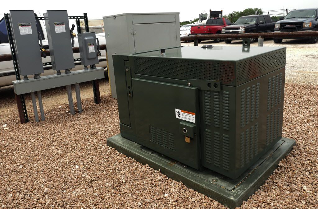 The Smart Grid CES (Community Energy Storage) is a battery system that extends about 4 feet underground to supply homes and businesses with another power source. Photographed at the Oncor facility in Lancaster in May,  2014. (Staff Photo)