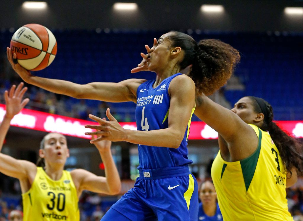 Dallas Wings guard Skylar Diggins-Smith (4) gets fouled by  Seattle Storm center Courtney Paris (3) during the first half at College Park Center in Arlington on Saturday, June 2, 2018. (Jae S. Lee/The Dallas Morning News)