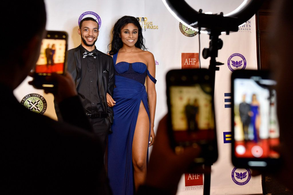 Alexander Miller, 25, of Kentucky, left, and Jessica Zyrie, 26, of Houston, are photographed on the red carpet during the eighth annual Black Trans Advocacy Conference and awards gala at the Wyndham Suites Hotel in Dallas, Friday April 26, 2019.