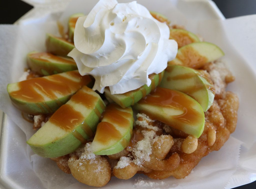 This is a Caramel Apple Funnel Cake. It comes with fresh apple slices, whip cream, and caramel drizzle. Funnel Cake Paradise is located in Dallas, Texas where you can purchase over 210 funnel cake combinations year-round. (Benjamin M. Robinson/The Dallas Morning News)