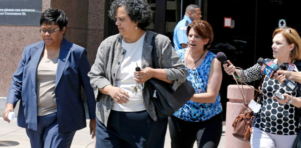 Kathy Nealy (left) will be tried at a later date. (2014 File Photo/David Woo)