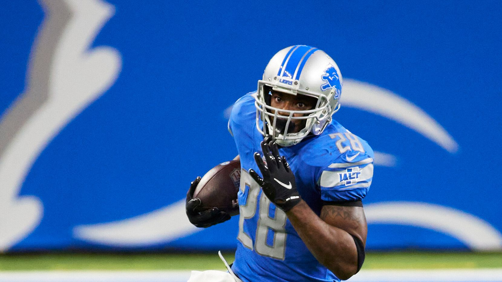 Detroit Lions running back Adrian Peterson (28) rushes against the Minnesota Vikings during an NFL football game, Saturday, Jan. 3, 2021, in Detroit. (AP Photo/Rick Osentoski)
