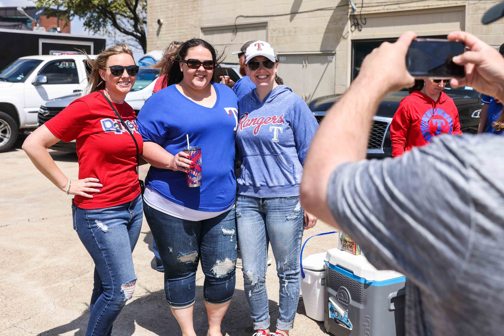 Alyssa Mitchell, Kristin Griffin and Melissa Cade pose together for a photo outside the Globe Life Field in Arlington, Texas on Monday, April 5, 2021,  before the game between Texas Rangers and Toronto Blue Jays on opening day. (Lola Gomez/The Dallas Morning News)
