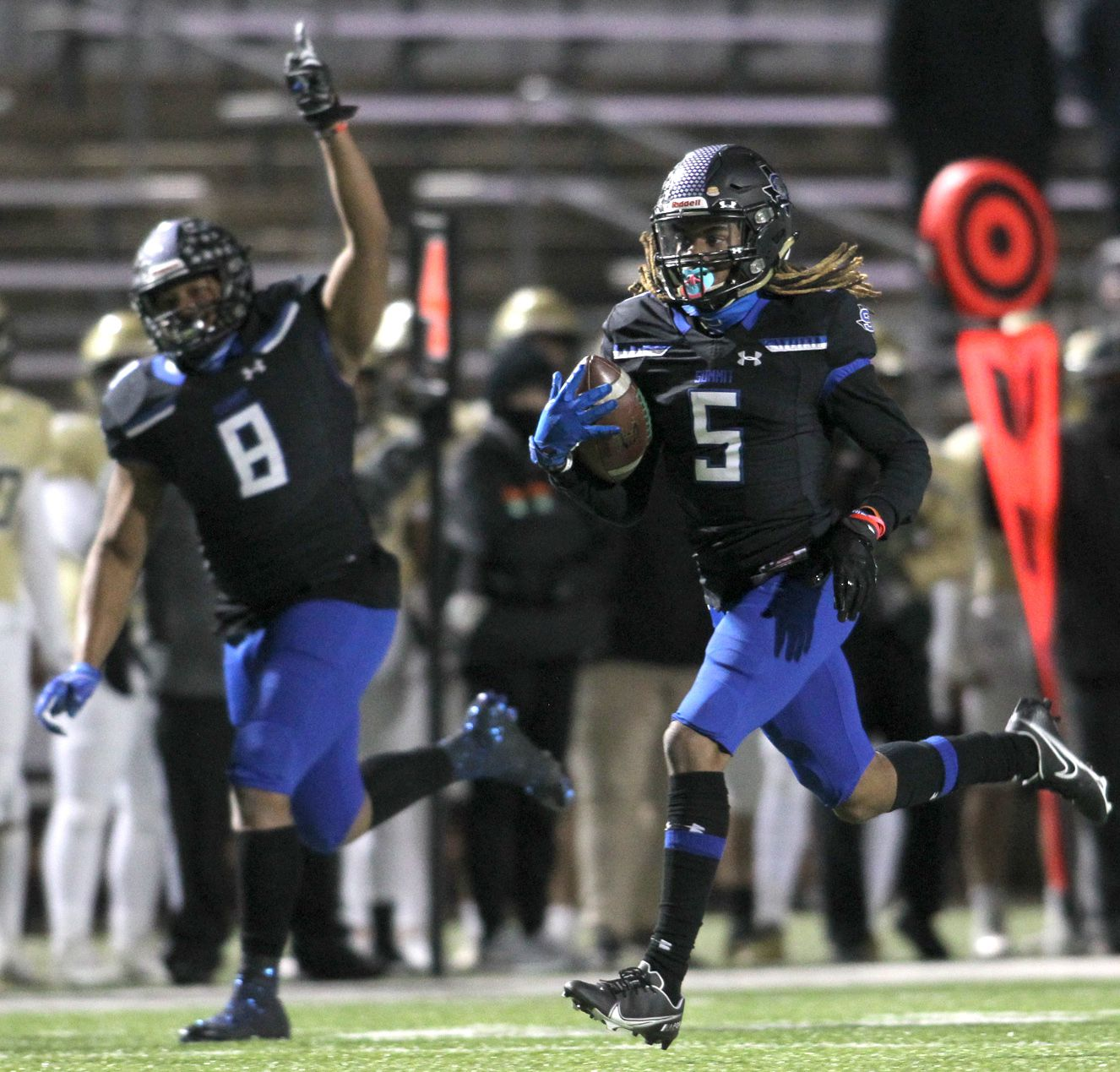 Mansfield Summit defensive back Sean Smith (5) sprints to the end zone to score a first quarter touchdown on a punt return against Birdville as teammate Kamren Washington (8) begins the celebration. The two teams played their District 4-5A Division l football game at Vernon Newsom Stadium in Mansfield on December 3, 2020. (Steve Hamm/ Special Contributor)