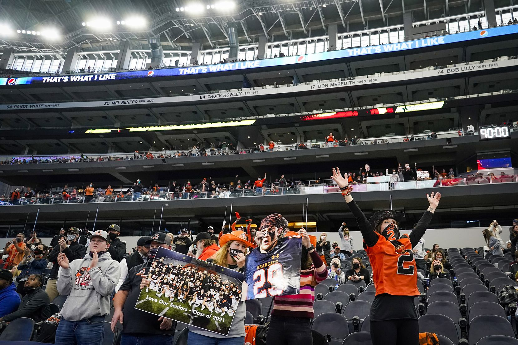 Aledo fans cheer as their team leaves the field with a lead over Crosby at the end of the first half of the Class 5A Division II state football championship game at AT&T Stadium on Friday, Jan. 15, 2021, in Arlington. (Smiley N. Pool/The Dallas Morning News)