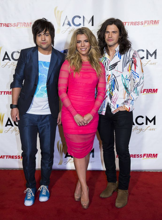 The Band Perry on the red carpet at the ACM Lifting Lives gala, from left: Neil Perry, Kimberley Perry and Reid Perry.