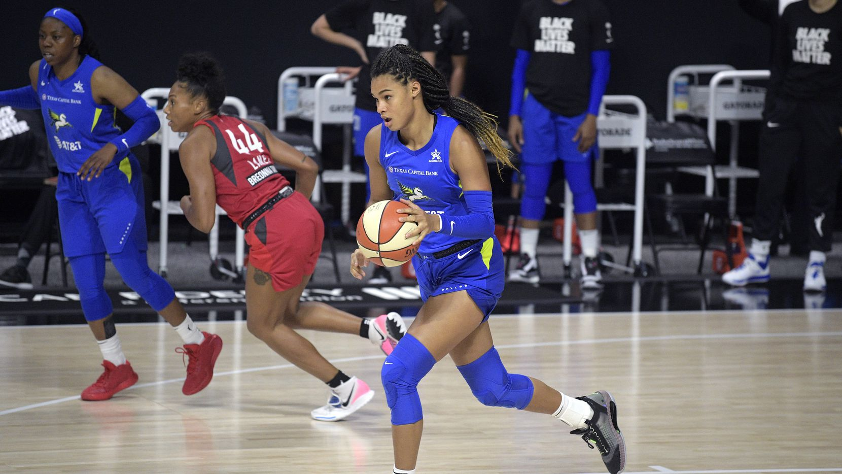 Dallas Wings forward Satou Sabally pushes the ball up the court during the second half of a WNBA basketball game against the Atlanta Dream, Sunday, July 26, 2020, in Bradenton, Fla.