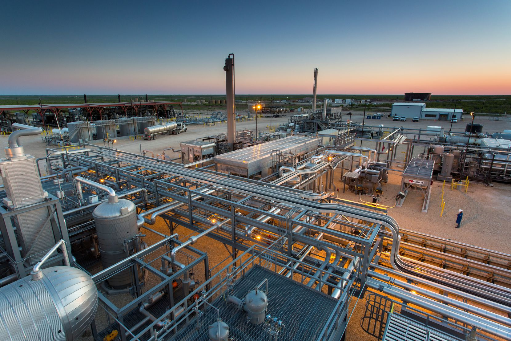 Exxon dramatically cut its spending this year in the oil-rich Permian Basin, where this EnLink Midstream plant is located.