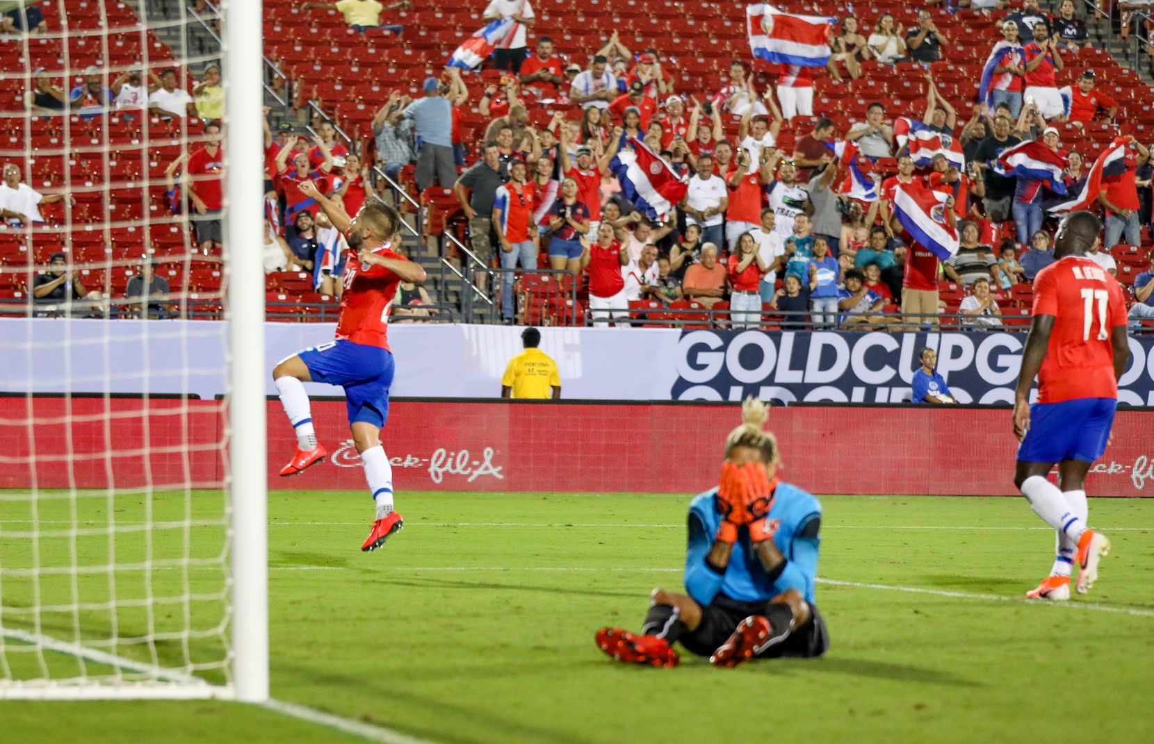 Elias Aguilar of Costa Rica celebrates his 54th minute goal in the 2019 Gold Cup at Toyota Stadium. Bermuda keeper Dale Eve sits distraught.