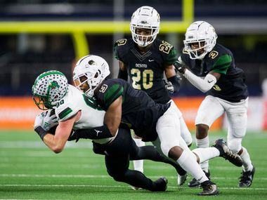 Southlake Carroll wide receiver John Manero (80) is tackled by DeSoto linebacker Ridarius Branch (9) with defensive backs Lathan Adams (20) and Devyn Bobby (3) during the fourth quarter of a Class 6A Division I area-round high school football playoff game between Southlake Carroll and DeSoto on Friday, November 22, 2019 at AT&T Stadium in Arlington. (Ashley Landis/The Dallas Morning News)