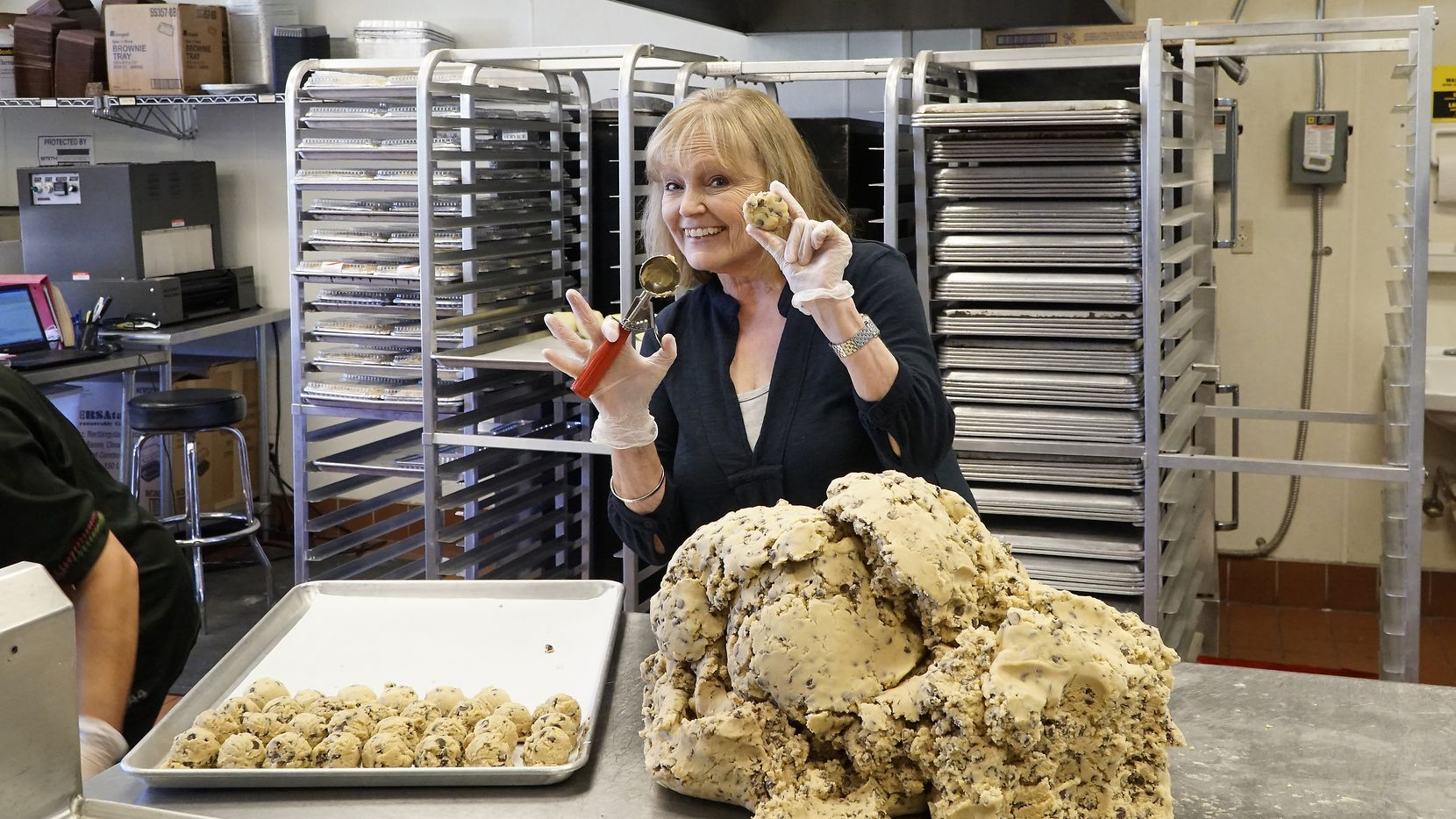 The Festive Kitchen owner Sandy Korem scoops the 8-millionth scoop of cookie dough at her store in Richardson, Texas on Monday, October 21, 2019.  (Lawrence Jenkins/Special Contributor)