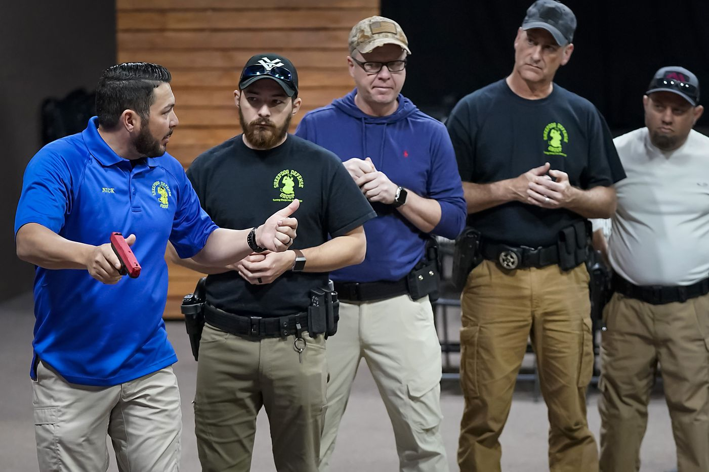 Instructor Nick Guadarama (left) demonstrates how to search and clear a room during a Sheepdog Defense Group armed security programs church safety training at Cornerstone Community Church on Sunday, Feb. 2, 2020 in Springtown, Texas.